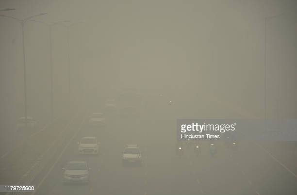 Vehicles ply on road amid heavy smog at NH 9 road on November 3 2019 in Ghaziabad India The air quality index hit 473 at 9 am according to Central...