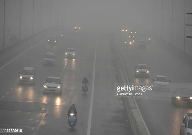 Vehicles ply on road amid heavy smog, at NH-9, near IP Extension, on November 3, 2019 in New Delhi, India. The air quality index hit 473 at 9 am,...