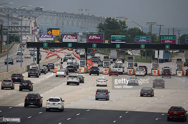 Vehicles prepare to travel across the Chesapeake Bay Bridge July 2 2015 in Annapolis Maryland Thousands are expected to travel by car to Maryland's...