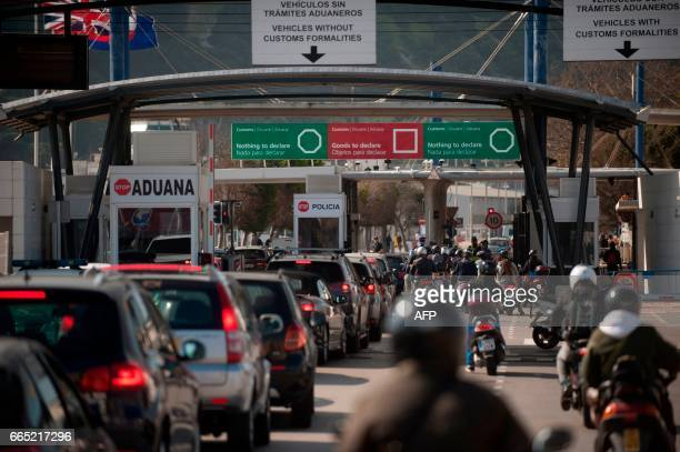 Vehicles queue at the border of the British Colony of Gibraltar in La Linea de la Concepcion on April 6, 2017. - Gibraltar on April 5, 2017 accused...