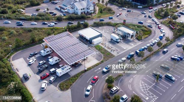 Vehicles queue for fuel at a Sainsbury's petrol station on September 24, 2021 in Weymouth, England. BP and Esso have announced that its ability to...