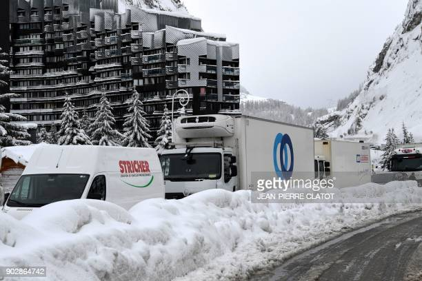 Vehicles queue in the village of Val d'Isere as the precautions are put into place due to an avalanche alert in the French Alpes on January 9 2018 /...