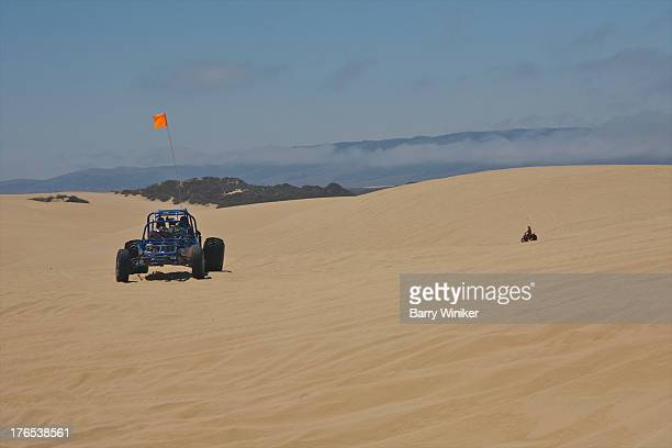 Vehicles racing on sand dunes