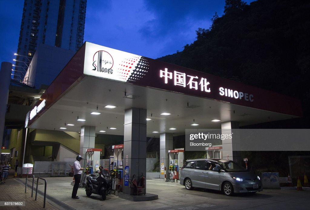 Vehicles refuel at a China Petroleum & Chemical Corp. (Sinopec) gas station at dusk in Hong Kong, China, on Tuesday, Aug. 22, 2017. Sinopec is scheduled to report second-quarter results on Aug. 25. Photographer: Vivek Prakash/Bloomberg via Getty Images