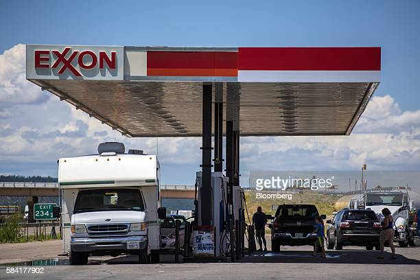 Vehicles refuel at a roadside Exxon gas station outside Aurora New Mexico US on Tuesday July 26 2016 Exxon Mobil Corp is scheduled to release...