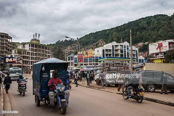Vehicles ride on a street of a Kigali popular district Kigali with a population of more than one million is Rwandas capital and main city The city is...