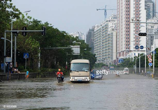 Vehicles run in flooded water in Shantou south China's Guangdong province on September 23 2013 after Typhoon Usagi landed in GuangdongTyphoon Usagi...