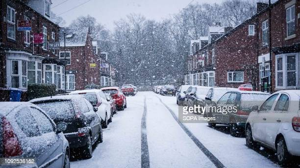 Vehicles seen parked during snowfall in Sheffield city center Cold Spell hits the Britain with snow and low temperatures