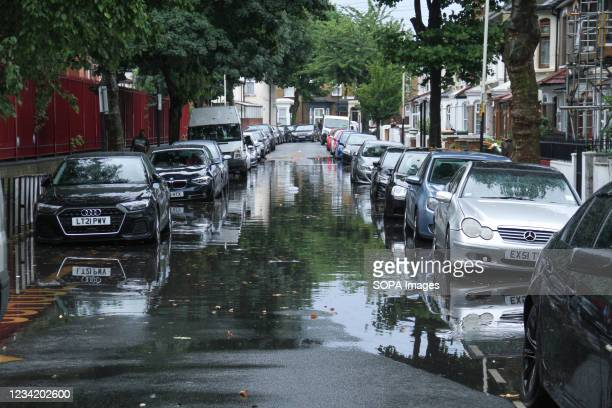 Vehicles seen parked on a flooded street in a suburb in East London following flash flooding today afternoon. Extreme heat in the previous week has...