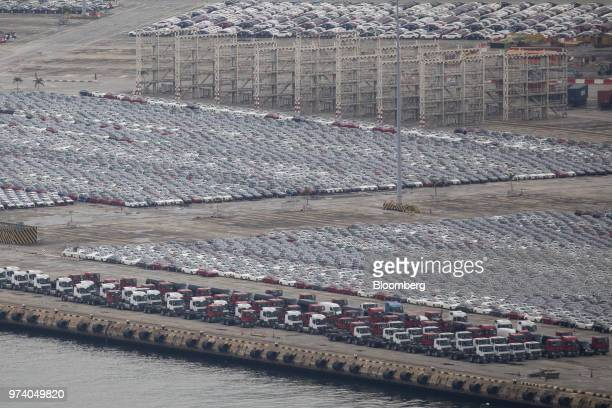 Vehicles sit in a lot at the Port of Singapore in Singapore on Wednesday June 13 2018 Tourism as well as the consumer sector will likely see a lift...