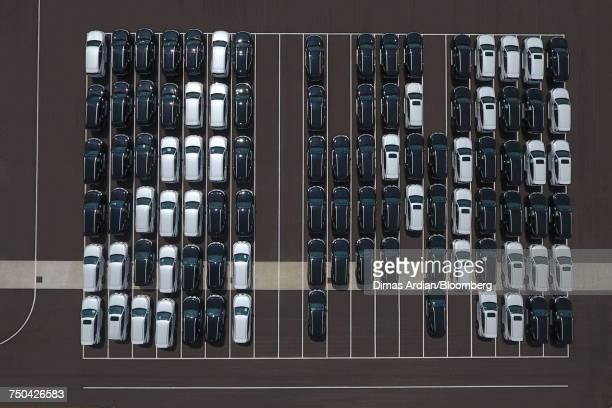 Vehicles sit in a parking lot