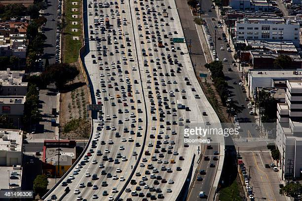 Vehicles sit in rush hour traffic on the Interstate 405 freeway in this aerial photograph taken over the Westwood neighborhood of Los Angeles...