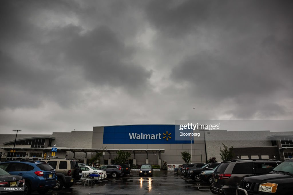 Vehicles sit in the parking lot of a Walmart Inc. store in Secaucus, New Jersey, U.S., on Wednesday, May 16, 2018. Walmart is scheduled to release earnings figures on May 17. Photographer: Timothy Fadek/Bloomberg via Getty Images