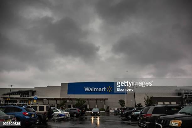 Vehicles sit in the parking lot of a Walmart Inc store in Secaucus New Jersey US on Wednesday May 16 2018 Walmart is scheduled to release earnings...