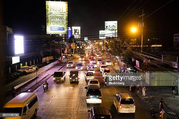 Vehicles sit in traffic on a highway at night in Davao Mindanao the Philippines on Friday Dec 11 2015 Davao city's reputation as one of the safest...