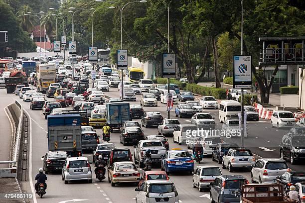 Vehicles sit in traffic on the Jalan Tun Razak road during the morning rush hour in Kuala Lumpur, Malaysia, on Tuesday, March 18, 2014. Malaysia,...