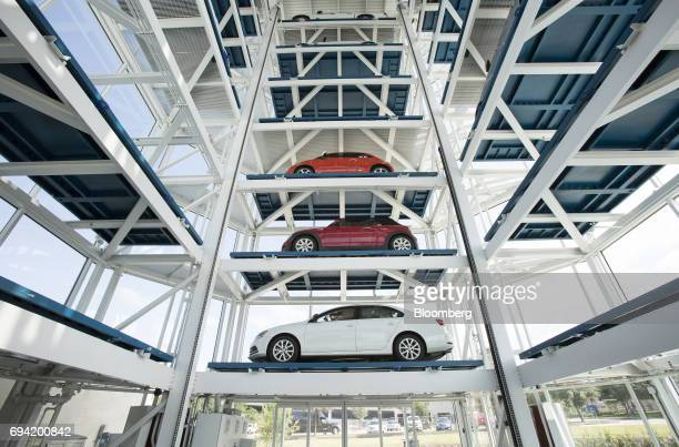 Vehicles sit inside the Carvana Co car vending machine in Frisco Texas US on Thursday June 8 2017 The US automotive industry may be struggling with...