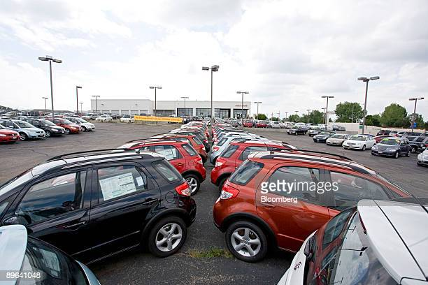 Vehicles sit on display at Denver Isuzu Suzuki in Denver Colorado US on Friday July 3 2009 Suzuki Motor Corp and Mitsubishi Motors Corp suffering...