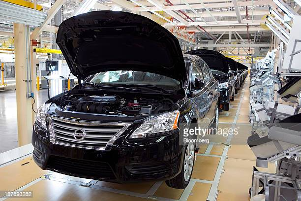 Vehicles sit on the production line at the new Nissan Motor Co assembly plant in Aguascalientes Mexico on Tuesday Nov 12 2013 Nissan Motor Co already...
