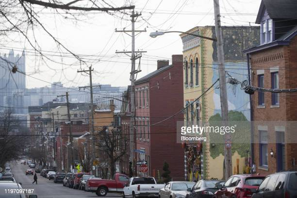 Vehicles sit parked along Arch Street on the North Side of Pittsburgh Pennsylvania US on Thursday Jan 23 2020 It's a sign of the times in Pittsburgh...