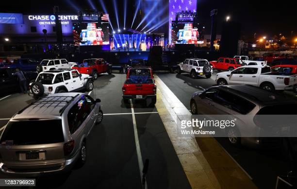 Vehicles sit parked at a drive-in election night event for Democratic presidential nominee Joe Biden at the Chase Center on November 03, 2020 in...