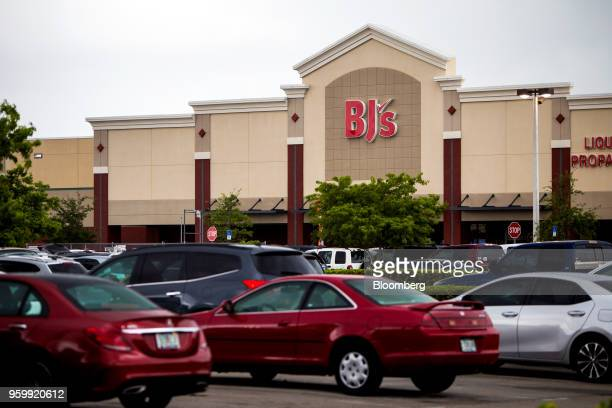 Vehicles sit parked outside a BJ's Wholesale Club Holdings Inc location in Miami Florida US on Thursday May 17 2018 The warehouseclub chain which had...
