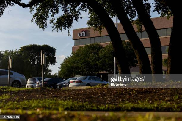 Vehicles sit parked outside a Citibank Operations Center in San Antonio Texas US on Wednesday July 11 2018 Citigroup Inc is scheduled to release...