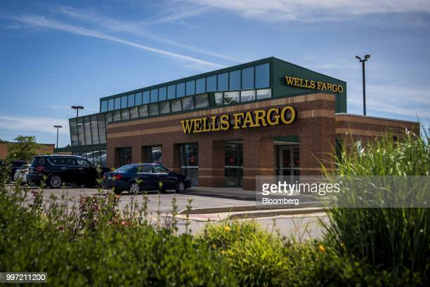 Vehicles sit parked outside a Wells Fargo Co bank branch in Palatine Illinois US on Tuesday July 10 2018 Wells Fargo Co is scheduled to release...