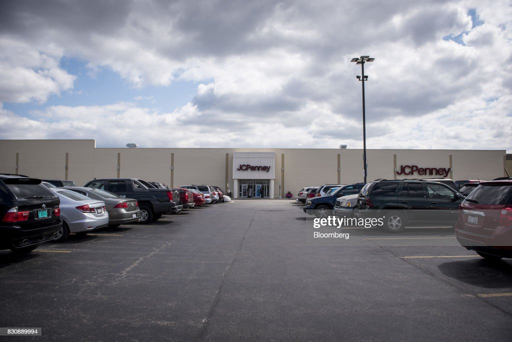 Vehicles sit parked outside of a JC Penney Co. store in Chicago, Illinois, U.S., on Saturday, Aug. 12, 2017. On Friday morning, JC Penney posted a deeper loss than analysts expected -- hurt by clearance sales -- sending the shares on their worst decline in more than four years. Photographer: Christopher Dilts/Bloomberg via Getty Images