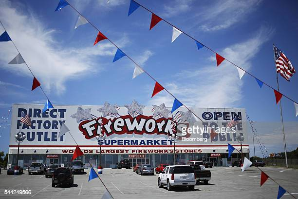 Vehicles sit parked outside of the Fireworks Supermarket store in Lenoir City Tennessee US on Friday July 1 2016 Fireworks sales expected to surge...