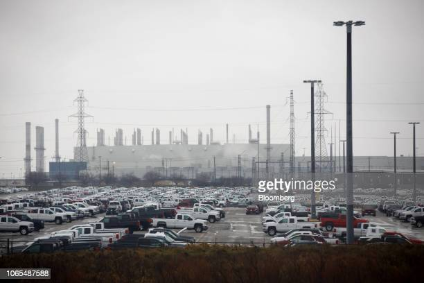 Vehicles sit parked outside of the General Motors Co Oshawa assembly plant in Oshawa Ontario Canada on Monday Nov 26 2018 General Motors Cosaid it...