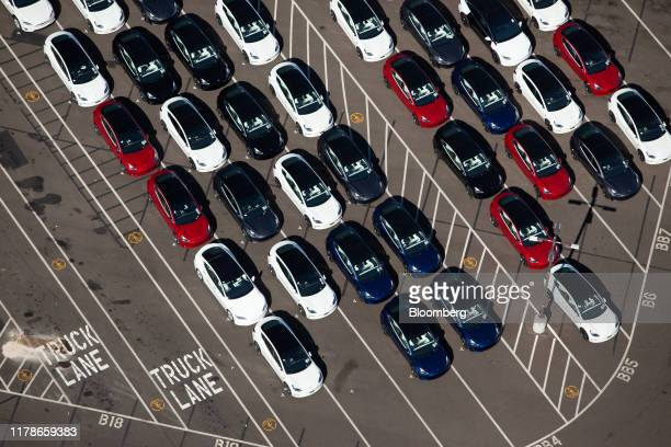 Vehicles sit parked outside of the Tesla Inc assembly plant in this aerial photograph taken above Fremont California US on Wednesday Oct 23 2019...