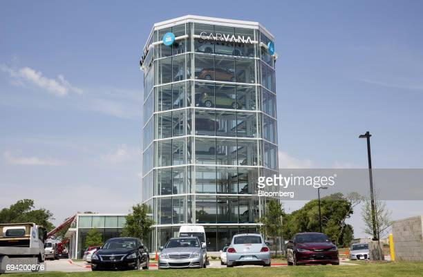 Vehicles sit parked outside the Carvana Co car vending machine in Frisco Texas US on Thursday June 8 2017 The US automotive industry may be...