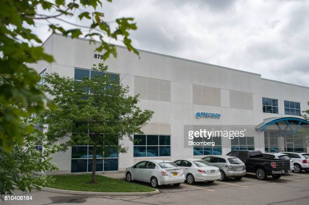 Vehicles sit parked outside the Precision Record Pressing facility in Burlington Ontario Canada on Friday June 30 2017 Precision is the world's first...