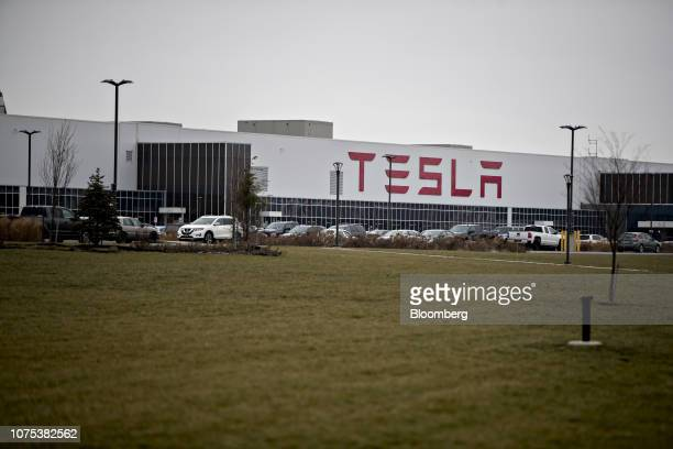 Vehicles sit parked outside the Tesla Inc. Solar panel factory in Buffalo, New York, U.S., on Wednesday, Dec. 26, 2018. Employees atthe factory this...