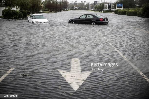 Vehicles sit submerged in floodwaters due to Hurricane Florence in Wilmington North Carolina US on Saturday Sept 15 2018 Florences plodding pace and...