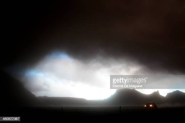Vehicles speed trough a dark fallout of ashes spewed by Eyjafjallajokull after the fallout completely blacked out visibility under the plume Picture...