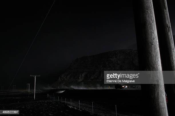 Vehicles speed trough a dark fallout of ashes spewed by Eyjafjallajokull after the fallout completely blacked out visibility under the plume on May...