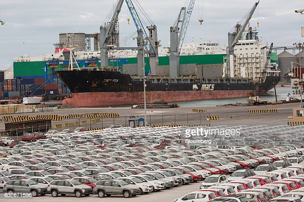 Vehicles stand in a lot before export from the Port of Veracruz in Veracruz Mexico on Sunday Jan 8 2017 The National Institute of Statistics and...