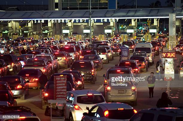Vehicles stand in early morning traffic at the San Ysidro Port of Entry for the US and Mexico border crossing in Tijuana Mexico on Thursday Jan 26...