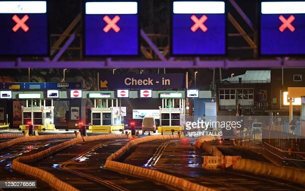 Vehicles start to pass through the check-in booths at the ferry terminal at the Port of Dover, in Dover in Kent, south east England, on December 23...