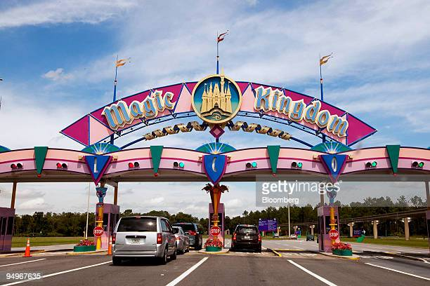 Vehicles stop at the payment entrance to Magic Kingdom at the Walt Disney World theme park and resort in Lake Buena Vista, Florida, U.S., on Monday,...