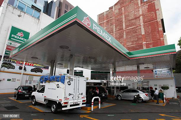 Vehicles stop to get gasoline at a Pemex station in Mexico City Mexico on Tuesday Jan 8 2013 Mexico's government is speeding up the removal of...