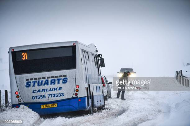 Vehicles struggle through snow on the B797 between Leadhills and Wanlockhead on February 11 2020 in Wanlockhead Scotland An amber weather warning of...