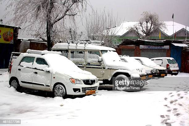 Vehicles stuck on the Naddi road as intense cold waves persists in the region with heavy snowfall on January 14 2015 in Dharamsala India Shimla and...