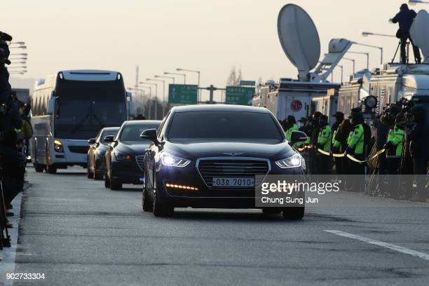 Vehicles transporting the South Korean delegation led by South Korean Unification Minister Cho MyoungGyon drive past a checkpoint on the road...