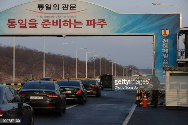Vehicles transporting the South Korean delegation led by South Korean Unification Ministrer Cho MyoungGyon drive past a checkpoint on the road...