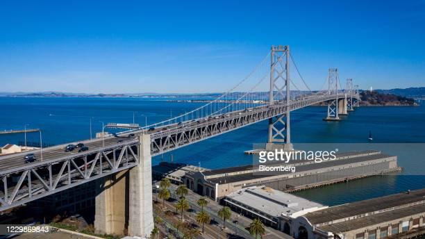 Vehicles travel across the San FranciscoOakland Bay Bridge in San Francisco, California, U.S., on Friday, Nov. 27, 2020. Californiareported 15,614...