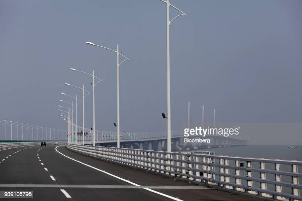 Vehicles travel along a section of the Hong KongZhuhaiMacau Bridge during a media tour of the bridge offshore in Zhuhai China on Wednesday March 28...