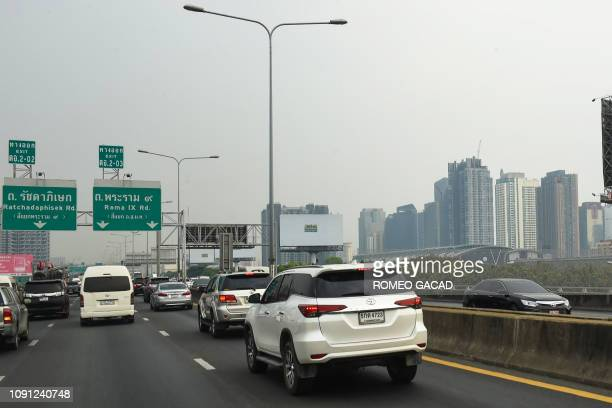 Vehicles travel along a toll road amid smog conditions in Bangkok on January 30 2019 Toxic smog forced hundreds of Bangkok schools to close on...